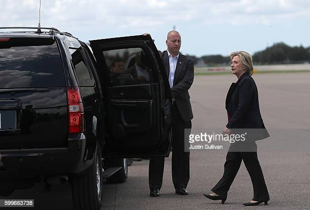 Democratic presidential nominee former Secretary of State Hillary Clinton gets into her vehicle at Tampa International Airport on September 6 2016 in...