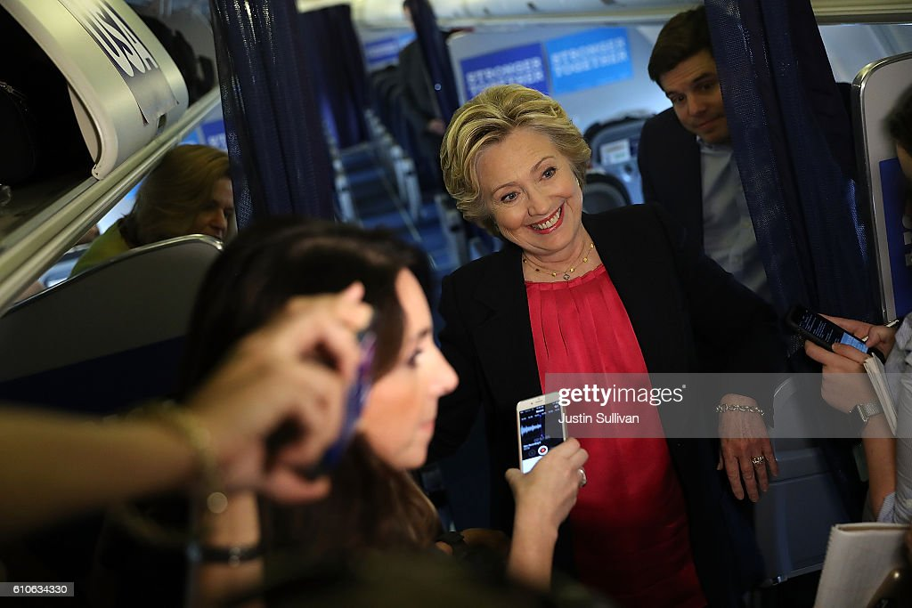 Democratic presidential nominee former Secretary of State Hillary Clinton speaks to reporters aboard her campaign plane before departing from Westchester County Airport on September 27, 2016 in White Plains, New York. Hillary Clinton is campaigning in North Carolina a day after facing off with Republican presidential nominee Donald Trump in the first presidential debate.