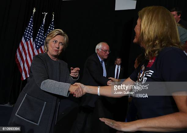 Democratic presidential nominee former Secretary of State Hillary Clinton and U.S. Sen. Bernie Sanders greet supporters during a campaign rally at...