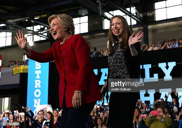 Democratic presidential nominee former Secretary of State Hillary Clinton and her daughter Chelsea Clinton greet supporters during a Family Town Hall...