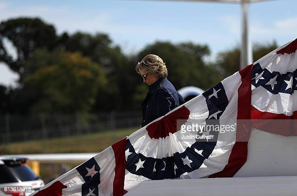 Democratic presidential nominee former Secretary of State Hillary Clinton arrives at LambertSt Louis International Airport on October 9 2016 in St...
