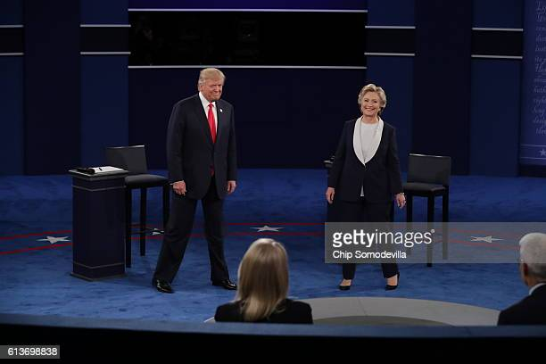 Democratic presidential nominee former Secretary of State Hillary Clinton and Republican presidential nominee Donald Trump arrive for the town hall...