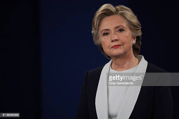 Democratic presidential nominee former Secretary of State Hillary Clinton listens to a question during the town hall debate at Washington University...