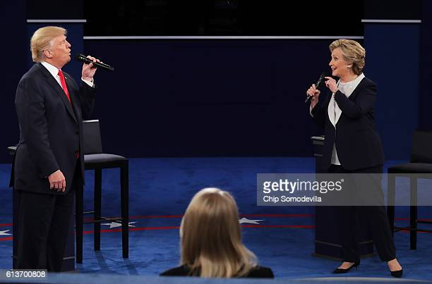 Democratic presidential nominee former Secretary of State Hillary Clinton and Republican presidential nominee Donald Trump speak during the town hall...