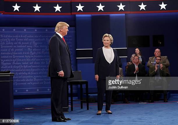 Democratic presidential nominee former Secretary of State Hillary Clinton and republican presidential nominee appear on stage at the start of the...