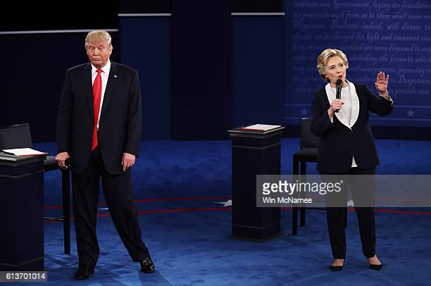 Democratic presidential nominee former Secretary of State Hillary Clinton speaks as Republican presidential nominee Donald Trump looks on during the...