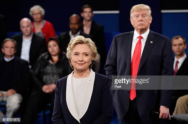 Democratic presidential nominee former Secretary of State Hillary Clinton and Republican presidential nominee Donald Trump listen during the town...