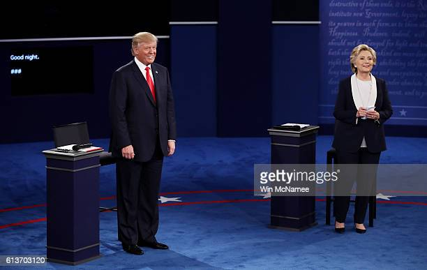 Democratic presidential nominee former Secretary of State Hillary Clinton and Republican presidential nominee Donald Trump listen to a question...