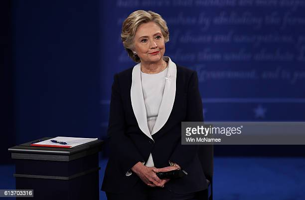 Democratic presidential nominee former Secretary of State Hillary Clinton listens during the town hall debate at Washington University on October 9...