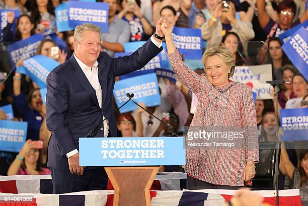 Democratic presidential nominee former Secretary of State Hillary Clinton and Vice President Al Gore are seen as they campaign together at the Miami...