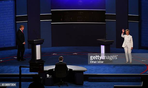 Democratic presidential nominee former Secretary of State Hillary Clinton and Republican presidential nominee Donald Trump walk onto the stage during...