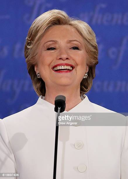 Democratic presidential nominee former Secretary of State Hillary Clinton laughs during the third US presidential debate at the Thomas Mack Center on...