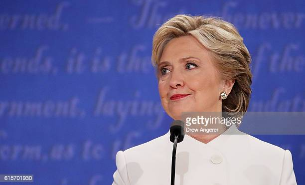 Democratic presidential nominee former Secretary of State Hillary Clinton listens to Republican presidential nominee Donald Trump speak during the...