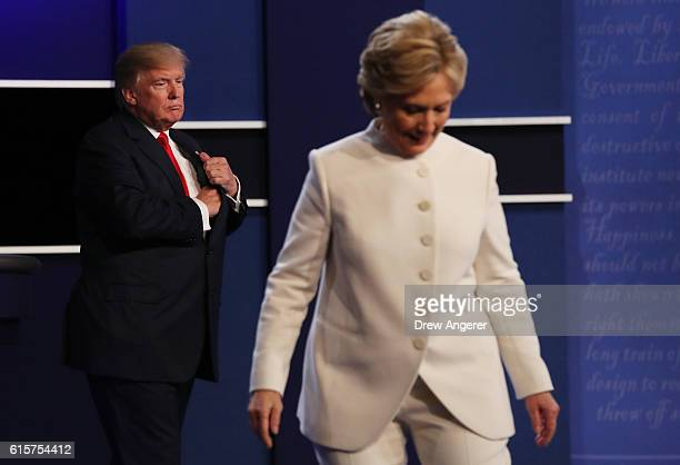 Democratic presidential nominee former Secretary of State Hillary Clinton walks off stage as Republican presidential nominee Donald Trump looks on...