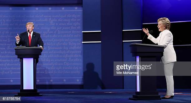 Democratic presidential nominee former Secretary of State Hillary Clinton debates with Republican presidential nominee Donald Trump during the third...