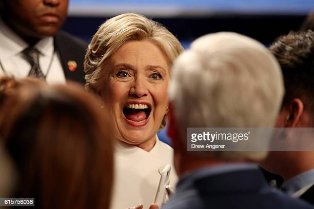 Democratic presidential nominee former Secretary of State Hillary Clinton speaks to guests after the third US presidential debate at the Thomas Mack...