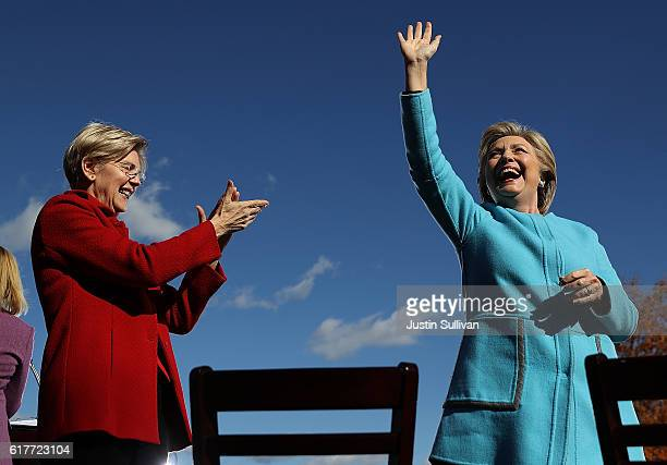 Democratic presidential nominee former Secretary of State Hillary Clinton and US Sen Elizabeth Warren greet supporters during a campaign rally at...