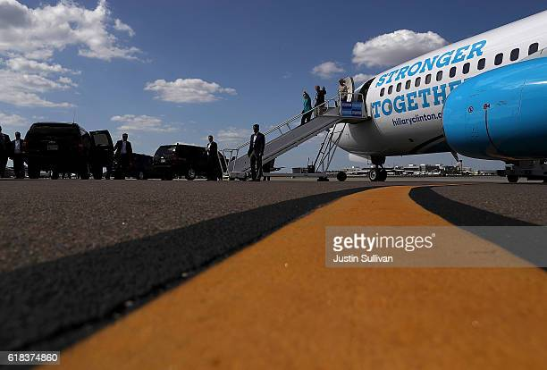 Democratic presidential nominee former Secretary of State Hillary Clinton and US Sen Bill Nelson arrive at Tampa International Airport on October 26...
