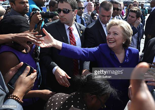 Democratic presidential nominee former Secretary of State Hillary Clinton greets early voters at an early voting site on November 2, 2016 in...