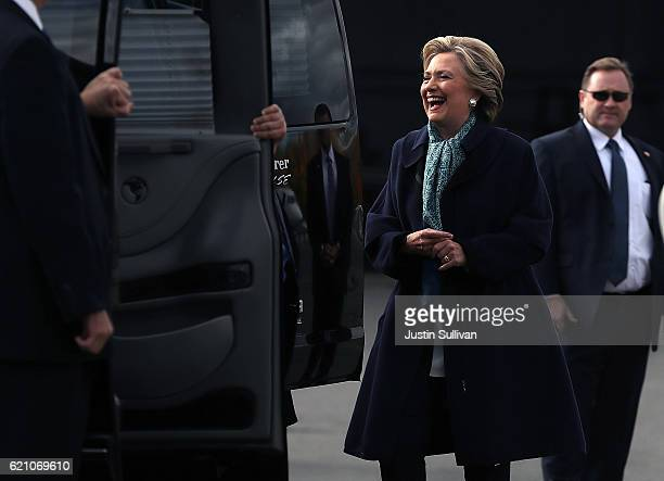 Democratic presidential nominee former Secretary of State Hillary Clinton waves as she boards her campaign plane at Westchester County Airport on...