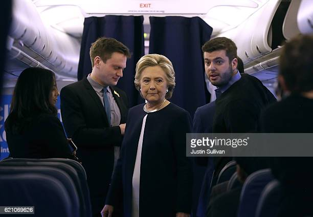 Democratic presidential nominee former Secretary of State Hillary Clinton talks with members of her staff aboard her campaign plane at Westchester...