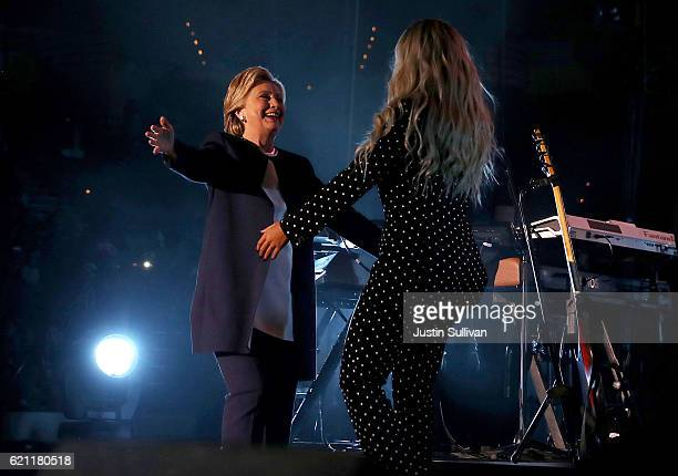 Democratic presidential nominee former Secretary of State Hillary Clinton greets recording artist Beyonce during a Get Out The Vote concert at...