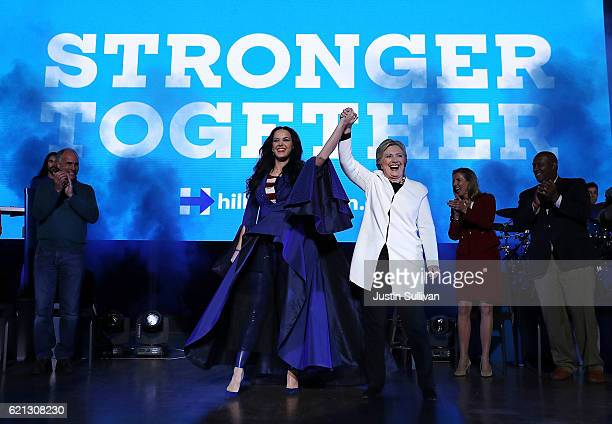 Democratic presidential nominee former Secretary of State Hillary Clinton raises her arms with recording artist Katy Perry during a getoutthevote...
