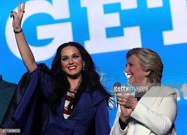 Democratic presidential nominee former Secretary of State Hillary Clinton and recording artist Katy Perry greet supporters during a getoutthevote...