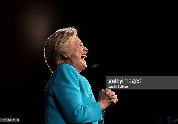 Democratic presidential nominee former Secretary of State Hillary Clinton laughs during a campaign rally at the Cleveland Public Auditorium on...