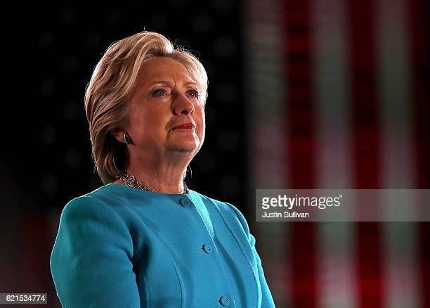 Democratic presidential nominee former Secretary of State Hillary Clinton looks on during a campaign rally at The Armory on November 6 2016 in...