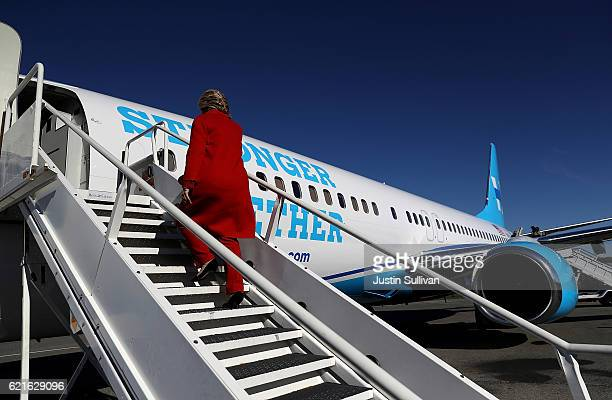 Democratic presidential nominee former Secretary of State Hillary Clinton boards her campaign plane at Westchester County Airport on November 7, 2016...