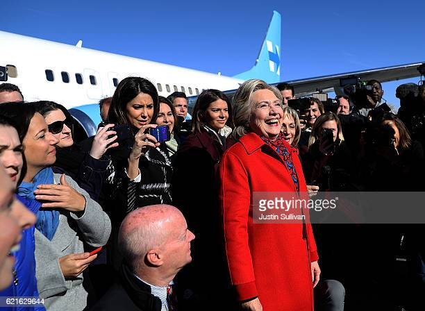 Democratic presidential nominee former Secretary of State Hillary Clinton prepares to take a picture with members of her traveling press before...