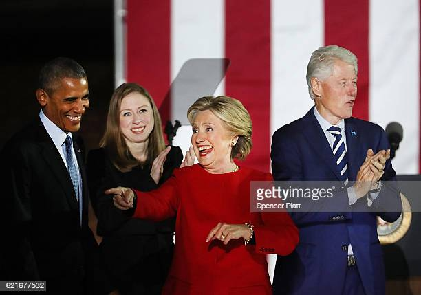 Democratic presidential nominee former Secretary of State Hillary Clinton stands with President Barack Obama former President Bill Clinton and...