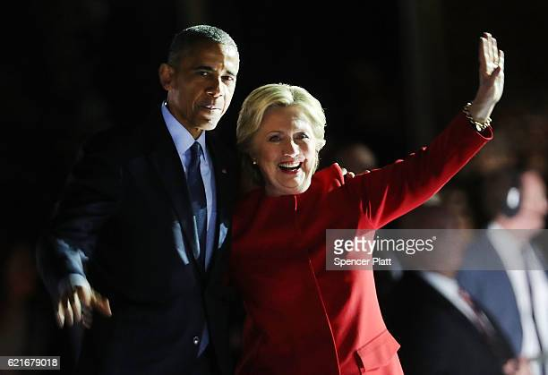 Democratic presidential nominee former Secretary of State Hillary Clinton stands with President Barack Obama during an election eve rally on November...