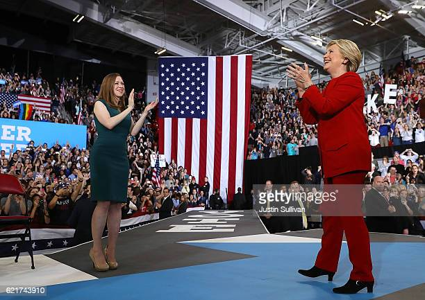 Democratic presidential nominee former Secretary of State Hillary Clinton and her daughter Chelsea greet supporters during a campaign rally at North...