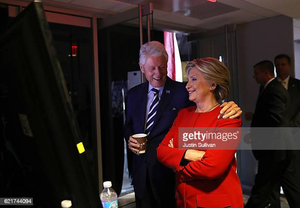 Democratic presidential nominee former Secretary of State Hillary Clinton and her husband former US President Bill Clinton watch Lady Gaga perform on...
