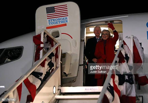 Democratic presidential nominee former Secretary of State Hillary Clinton and her husband former U.S. President Bill Clinton greet supporters at...