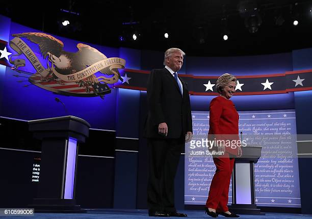 Democratic presidential nominee Hillary and Republican presidential nominee Donald Trump appear on stage before the start of the first presidential...