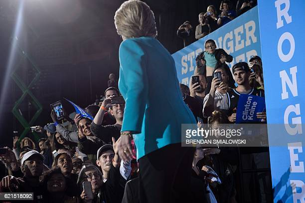 Democratic presidential nominee Hillary Clinton acknowledges supporters after speaking a rally at the Cleveland Public Auditorium November 6 2016 in...