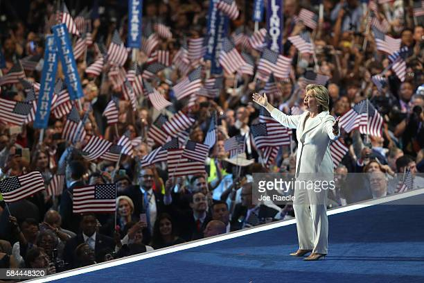 Democratic presidential nominee Hillary Clinton acknowledges the crowd as she arrives on stage during the fourth day of the Democratic National...