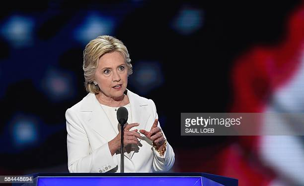 Democratic presidential nominee Hillary Clinton addresses delegates during the fourth and final night of the Democratic National Convention at Wells...