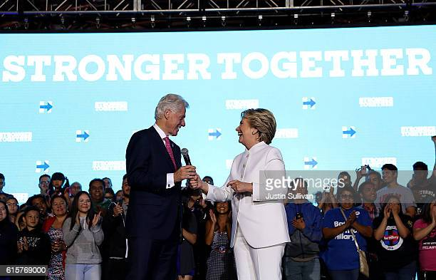 Democratic presidential nominee Hillary Clinton and her husband former US president Bill Clinton speak during a debate watch party at Craig Ranch...