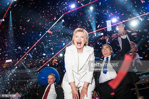 Democratic presidential nominee Hillary Clinton and her running mate Tim Kaine, left, wave to the crowd at the Wells Fargo Center in Philadelphia,...