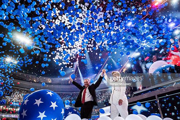 Democratic presidential nominee Hillary Clinton and her running mate Tim Kaine wave to the crowd at the Wells Fargo Center in Philadelphia Pa on the...