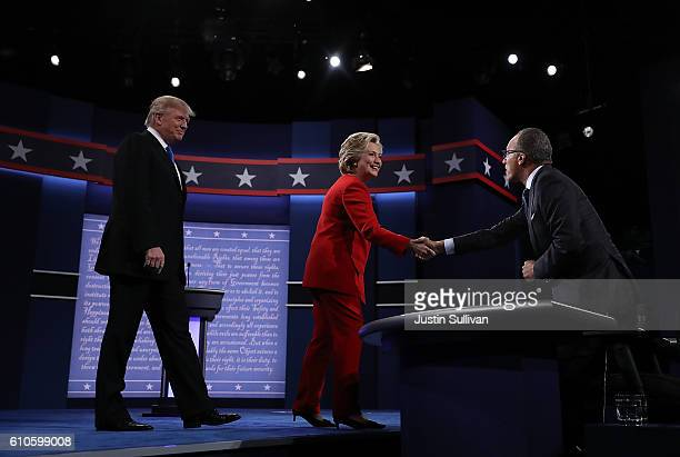 Democratic presidential nominee Hillary Clinton and Republican presidential nominee Donald Trump greet NBC's Lester Holt before the start of the...