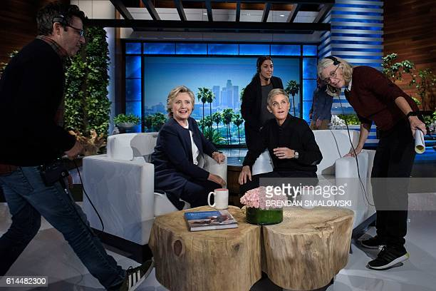 Democratic presidential nominee Hillary Clinton and tv host Ellen DeGeneres wait during a commercial break of the taping of the Ellen Show on October...