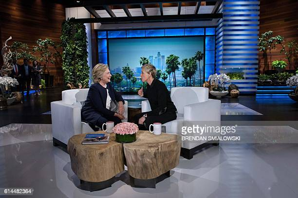 Democratic presidential nominee Hillary Clinton and tv host Ellen DeGeneres talk during a commercial break of the taping of the Ellen Show on October...
