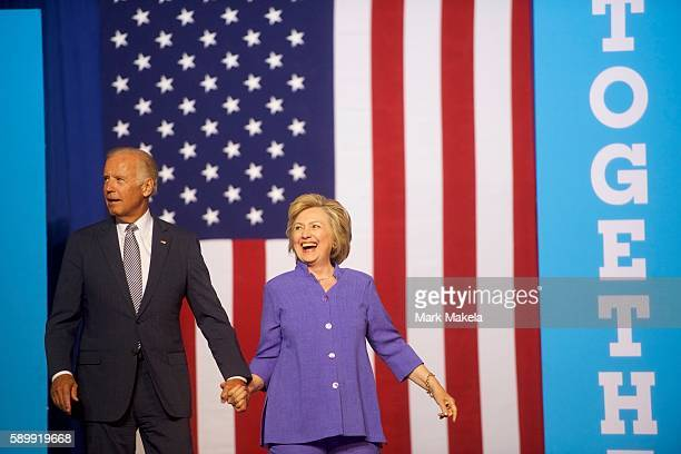 Democratic Presidential nominee Hillary Clinton and US Vice President Joe Biden acknowledge the crowd at Riverfront Sports athletic facility on...