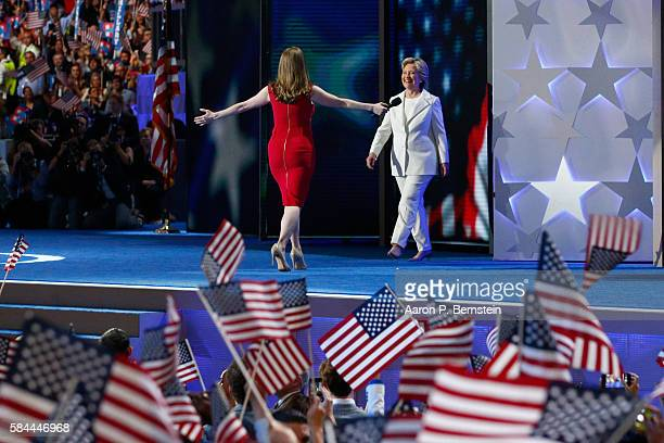 Democratic presidential nominee Hillary Clinton arrives on stage after her daughter Chelsea Clinton introduces her on the fourth day of the...