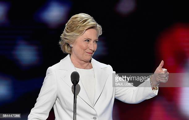 Democratic presidential nominee Hillary Clinton arrives on stage during the fourth and final night of the Democratic National Convention at Wells...